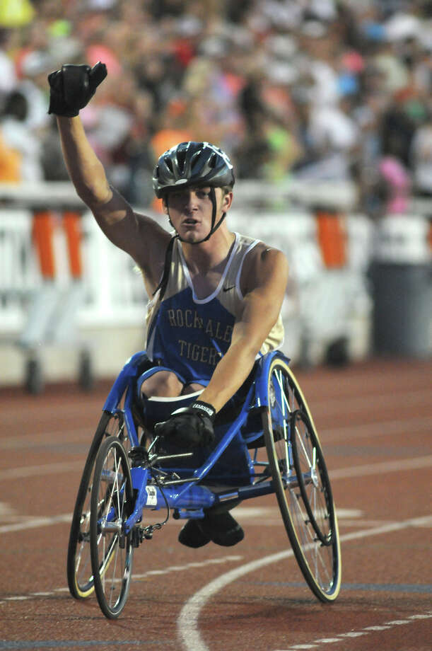 Rockdale's Dustin Strelsky celebrates his win in the Boys 400 Meter Dash Wheelchair event during the UIL State Track & Field Championships at Mike A. Myers Stadium in Austin on Saturday. Photo: Jerry Baker, For The Chronicle