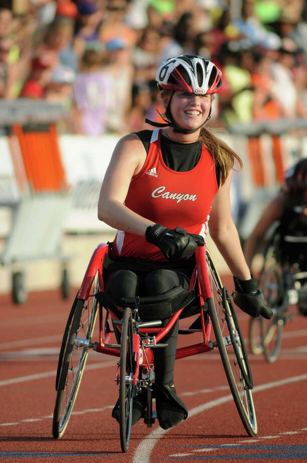 New Braunsfel Canyon's Abby Dunkin celebrates her win in the Girls 100 Meter Dash Wheelchair event during the UIL State Track & Field Championships at Mike A. Myers Stadium in Austin on Saturday. Photo: Jerry Baker, For The Chronicle