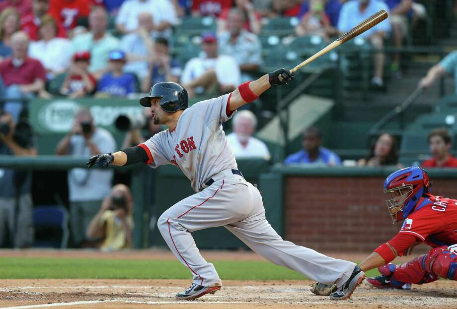 ARLINGTON, TX - MAY 10:  Shane Victorino #18 of the Boston Red Sox drives in a run against the Texas Rangers in the second inning at Globe Life Park in Arlington on May 10, 2014 in Arlington, Texas.  (Photo by Ronald Martinez/Getty Images) ORG XMIT: 477583051 Photo: Ronald Martinez / 2014 Getty Images