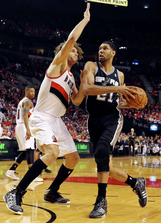 San Antonio Spurs' Tim Duncan looks for room around Portland Trail Blazers' Robin Lopez during first half action of Game 3 in the Western Conference semifinals Saturday May 10, 2014 at the Moda Center in Portland, OR. Photo: Edward A. Ornelas, San Antonio Express-News / © 2014 San Antonio Express-News