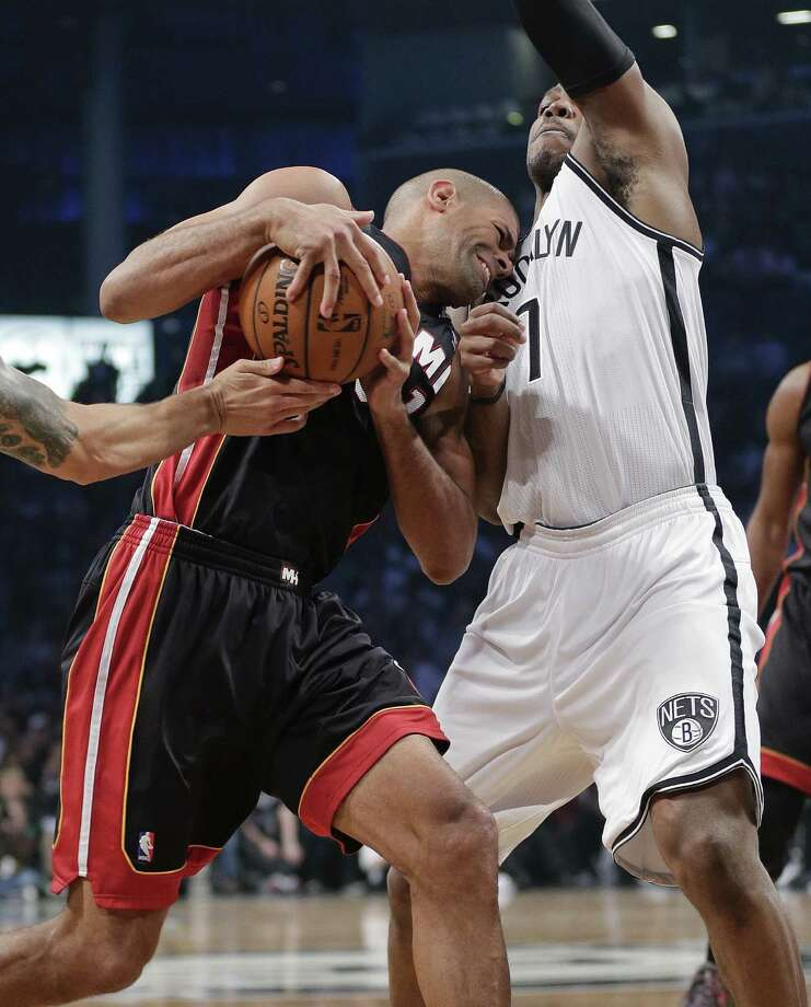 Miami's Shane Battier meets resistance in the form of Brooklyn's Joe Johnson during Game 3 of their Eastern Conference semifinal at the Barclays Center. Photo: Julie Jacobson / Associated Press / AP