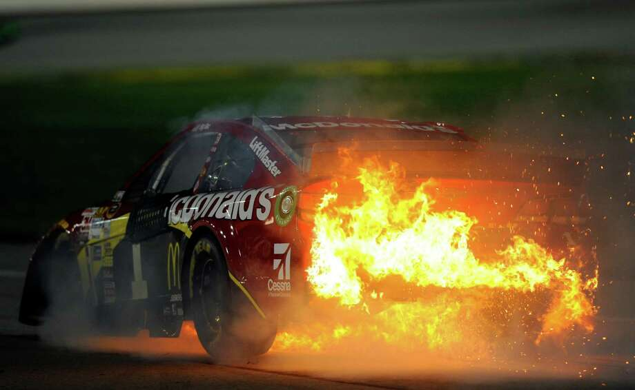 Jamie McMurray catches fire during the Sprint Cup Series 5-Hour Energy 400 at Kansas Speedway on Saturday night. He finished 39th out of 43 cars. Photo: Jared C. Tilton / Getty Images / 2014 Getty Images