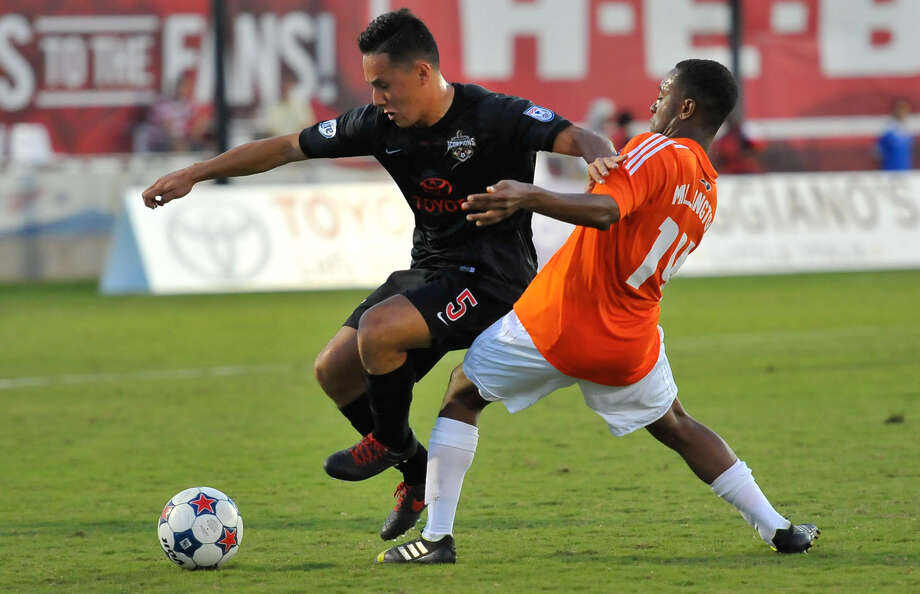 The Scorpions' Richard Menjivar (left) battles Carolina's Nick Millington in first-half action at Toyota Field in the home team's 3-0 victory Saturday night. Photo: Robin Jerstad / For The Express-News