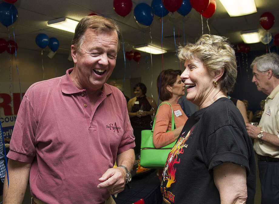 Joe Krier speaks with Bexar County Sheriff Susan Pamerleau at his campaign headquarters. Photo: Photos By Alma E. Hernandez / For The San Antonio Express-News
