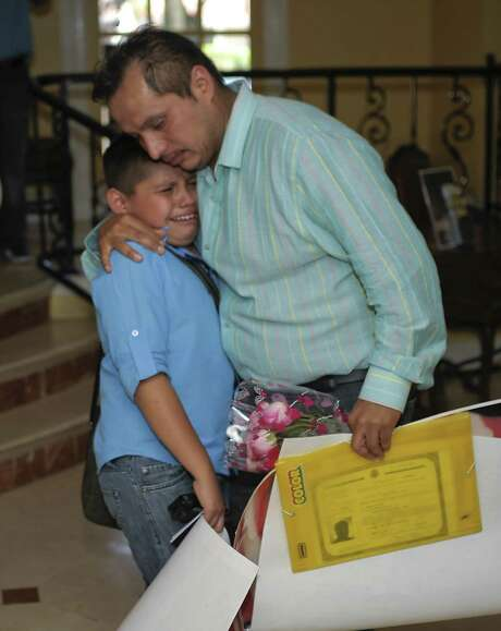 Said Salmeron cries in the arms of his father, Gustavo Salmeron, after being reunited in Laredo, crossing back to the U.S. from Nuevo Laredo. Photo: Danny Zaragoza / Laredo Morning Times / LAREDO MORNING TIMES