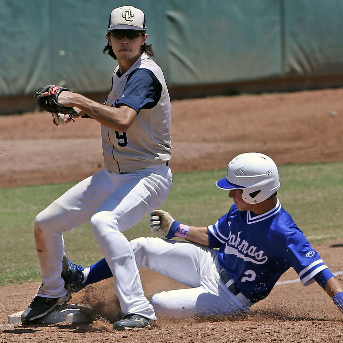 O'Connor's Dillon Stumpf forces out MacArthur's Bobby Lepovitz at third base to help end a late-inning rally attempt.