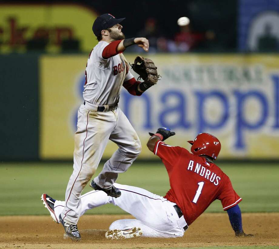 Boston second baseman Dustin Pedroia throws to first to complete a double play after forcing out Texas' Elvis Andrus in the eighth inning. Photo: Jim Cowsert / Associated Press / FR170531 AP