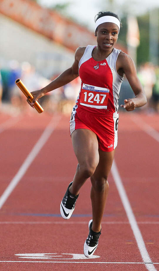 Judson's Talajah Murrell crosses the finish line to win the Class 5A 800-meter relay. Photo: Marvin Pfeiffer / Express-News / Express-News 2014