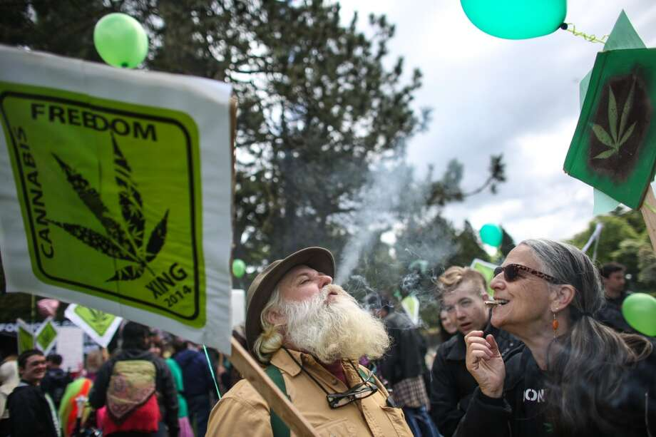 Farmer Tom and Grandma Cat share marijuana during the Cannabis Freedom March. Marchers were advocating for legalization of home grown marijuana and for continued access to marijuana for medical patients. Photographed on Saturday, May 10, 2014. (Joshua Trujillo, seattlepi.com) Photo: JOSHUA TRUJILLO, SEATTLEPI.COM