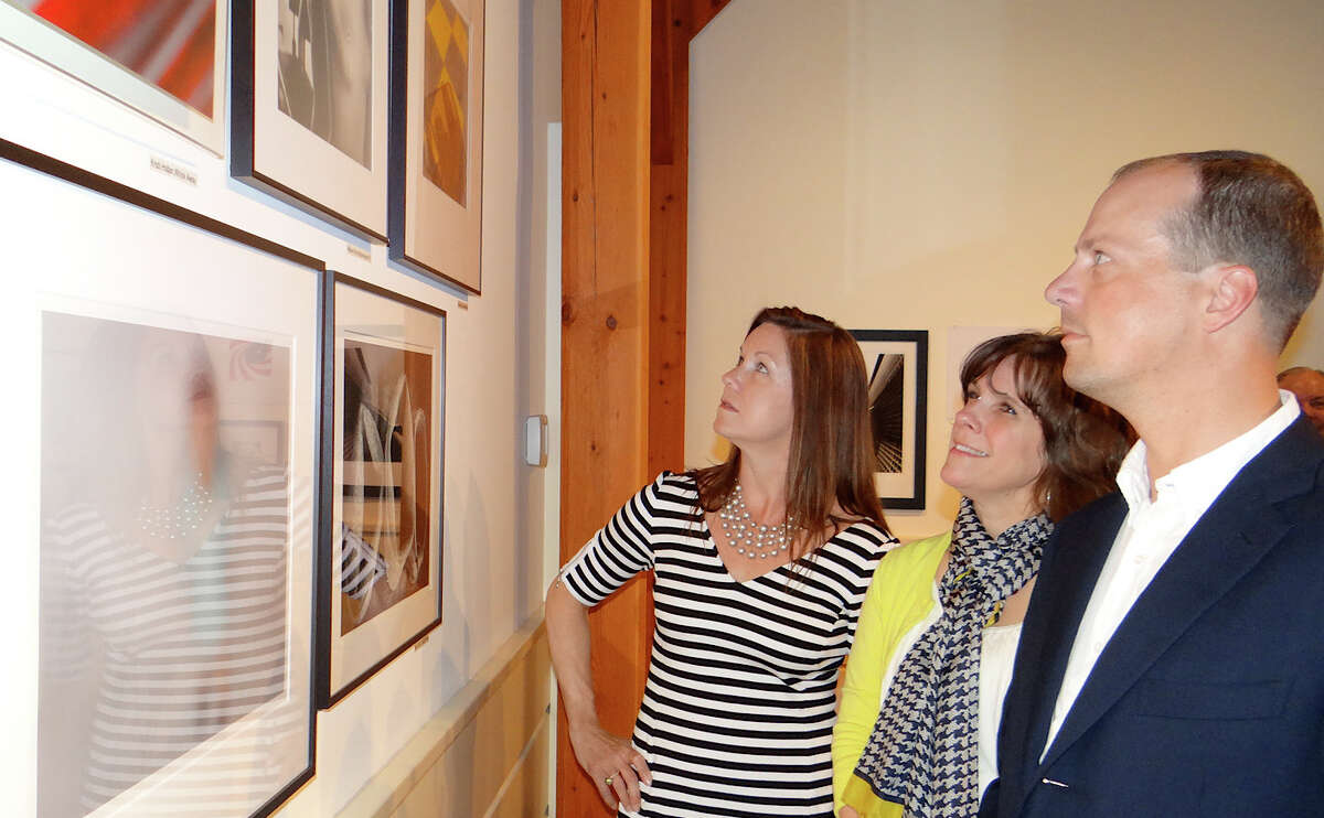 Southport residents Bobbie Sue and Bill Russell flank Meighan Dutt of Newtown at the Fairfield Museum and History Center's Images 2014 reception Saturday.