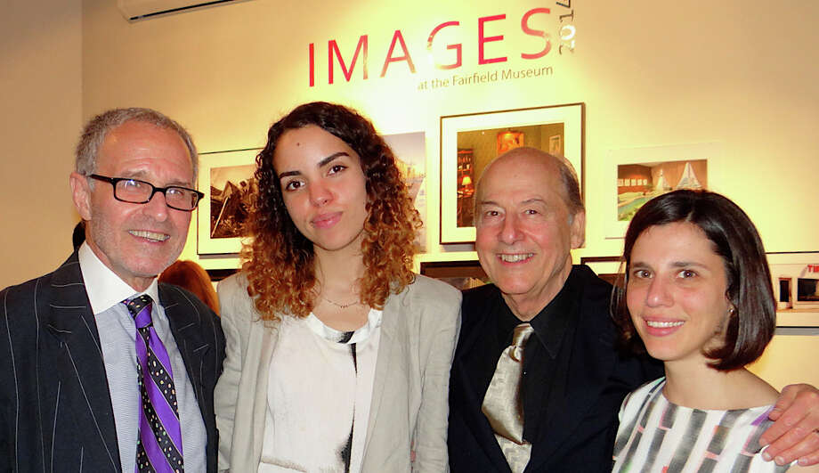 Images 2014 photo exhibit judges Jordan Schaps, Lisa Larson-Walker and Philip Trager, with curator Andrea Renner, at the opening reception Saturday night. Photo: Mike Lauterborn / Fairfield Citizen