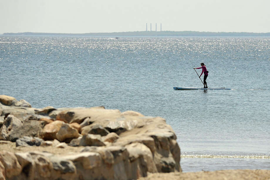 Suzanne Timerman paddles the Long Island Sound near the Greenwich Point Park beach in Greenwich, Conn., on Sunday, May 11, 2014. Photo: Jason Rearick / Stamford Advocate