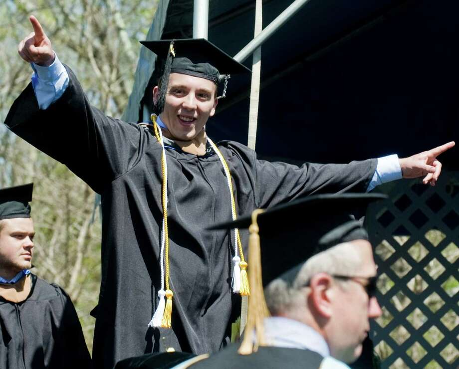 Kyle Morin celebrates as he walks across the stage to receive his diploma during the graduation ceremony at Western Connecticut State University. Sunday, May 11, 2014 Photo: Scott Mullin / The News-Times Freelance