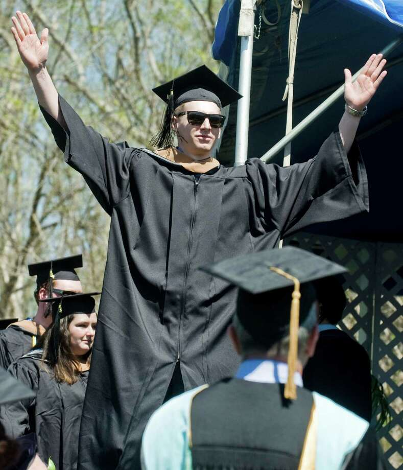 Bradley Troisi acknowledges the crowd as he walks across the stage to receive his diploma during the graduation ceremony at Western Connecticut State University. Sunday, May 11, 2014 Photo: Scott Mullin / The News-Times Freelance