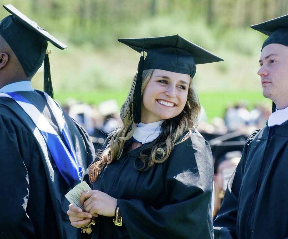 Michelle Davies waits in line to receiver her diploma during the graduation ceremony at Western Connecticut State University. Sunday, May 11, 2014 Photo: Scott Mullin / The News-Times Freelance
