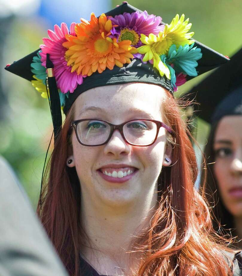 Molly Hennon decorated for the graduation ceremony at Western Connecticut State University. Sunday, May 11, 2014 Photo: Scott Mullin / The News-Times Freelance