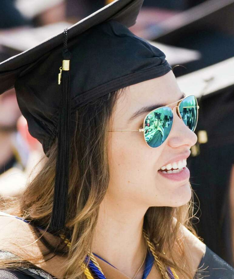 Amanda Campiolo enjoying the graduation ceremony at Western Connecticut State University. Sunday, May 11, 2014 Photo: Scott Mullin / The News-Times Freelance