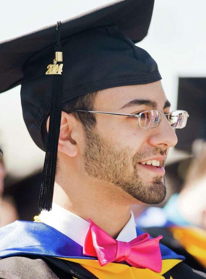 Rayan Hage enjoying the graduation ceremony at Western Connecticut State University. Sunday, May 11, 2014 Photo: Scott Mullin / The News-Times Freelance