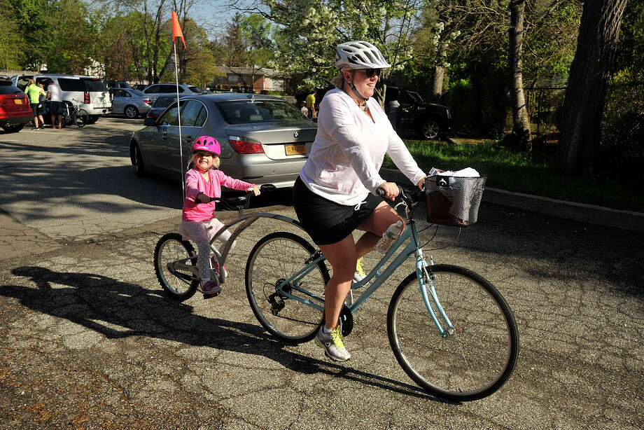 Julie Laine and her daughter, Grace, pedal the start of the 12th annual Old Greenwich - Riverside Community Center's Mother's Day Bike Ride at Old Greenwich Elementary School in Greenwich, Conn., on Sunday, May 11, 2014. Photo: Jason Rearick / Stamford Advocate
