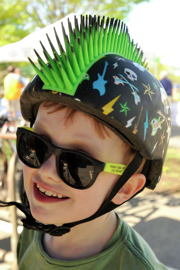 Harrison Thompson shows off his bicycle helmet after returning from the 12th annual Old Greenwich - Riverside Community Center's Mother's Day Bike Ride at Old Greenwich Elementary School in Greenwich, Conn., on Sunday, May 11, 2014. Photo: Jason Rearick / Stamford Advocate