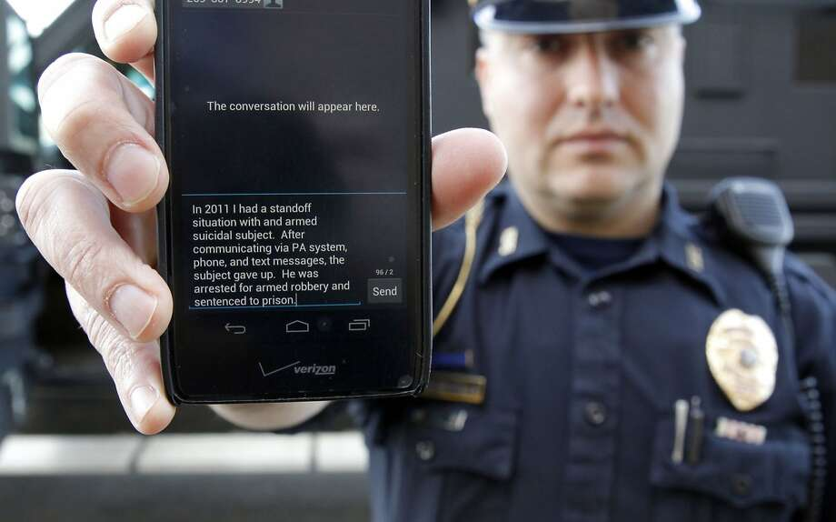 Police Sgt. Andres Wells used texting during a 2011 standoff in Kalamazoo, Mich. Photo: Mark Bugnaski, Associated Press