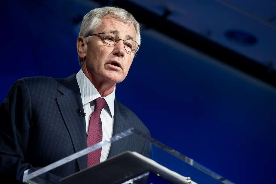 U.S. Defense Secretary Chuck Hagel says he is open to reviewing a policy that bars transgender individuals from military service. President Obama has not addressed the issue specifically. Photo: Nicholas Kamm, AFP/Getty Images