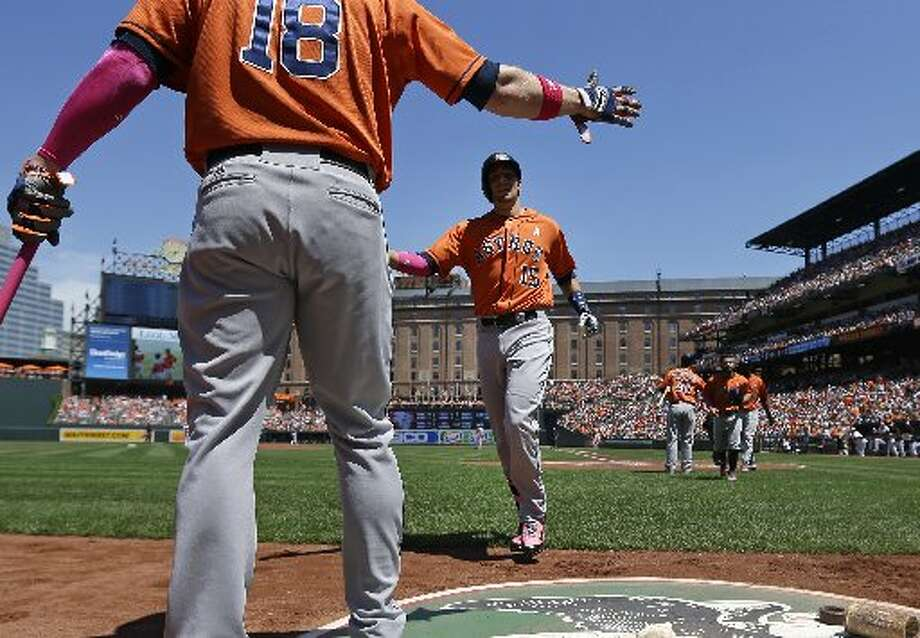 May 11: Astros 5, Orioles 2Jason Castro, center, jogs off the field toward teammate Marc Krauss after hitting a three-run home run in the first inning. Photo: Patrick Semansky, Associated Press