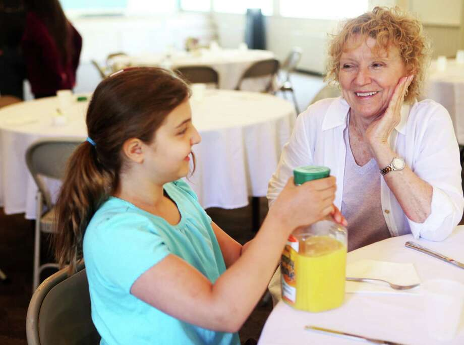 Viveca Schreiner, 9, of Westport, and her grandmother, Jackie Fenley, of Fairfield, attend the Sea Scouts of Ship 84 pancake breakfast at Trinity Episcopal Church in Southport on Sunday, May 11, 2014 Photo: BK Angeletti, B.K. Angeletti / Connecticut Post freelance B.K. Angeletti