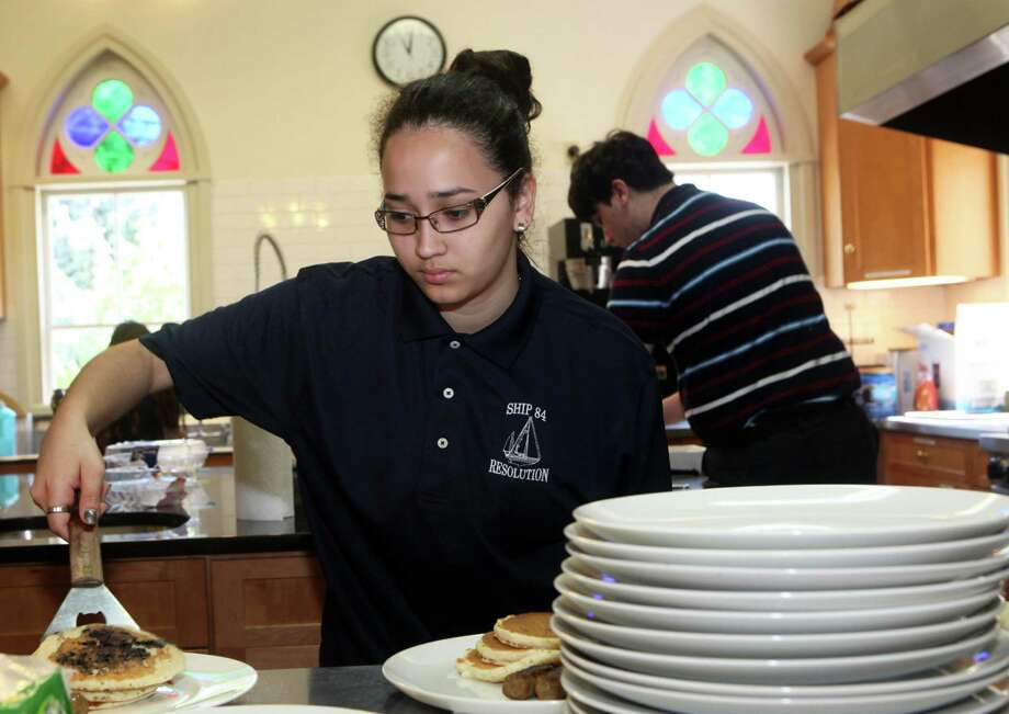 Sea Scout Lais Da Silva, 17, of Bridgeport, plates pancakes at the 3rd annual Mother's Day breakfast at Trinity Episcopal Church in Southport on Sunday, May 11, 2014. The breakfast benefits the sea scouts  ship 84. Photo: BK Angeletti, B.K. Angeletti / Connecticut Post freelance B.K. Angeletti