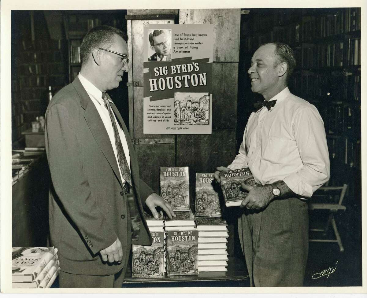 """Sigman Byrd, left, writer-columnist for Houston Chronicle, Post and Press. Here, Byrd is helping to promote his book """"Sig Byrd's Houston"""" in the mid-1950s."""
