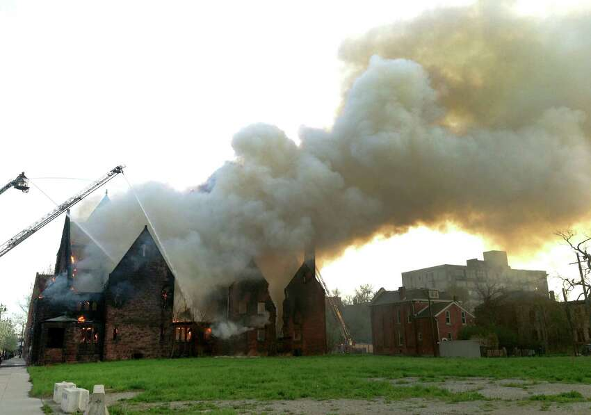 Firefighters spray water on the burning First Unitarian Church of Detroit on Woodward Ave. on Saturday, May 10, 2014. The Midtown Detroit church - vacant for a decade or more - was destroyed by fire. No injuries were reported.