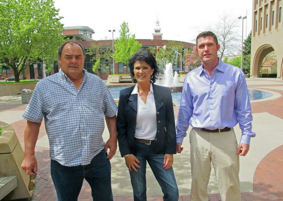 In this Thursday, May 8, 2014 photo, from left, Larry Harvey, Rhonda Firestack-Harvey, and Rolland Gregg stand in the plaza in front of the federal courthouse in Spokane, Wash. The three are charged with growing marijuana at a remote farm near Kettle Falls, Wash. Each face mandatory minimum sentences of at least 10 years in prison after they were caught growing about 70 pot plants on their rural, mountainous property. Medical marijuana advocates have cried foul, arguing the prosecution violates Department of Justice policies announced by Attorney General Eric Holder last year that nonviolent, small-time drug offenders shouldn't face lengthy prison sentences. Photo: Nicholas K. Geranios, AP  / AP2014