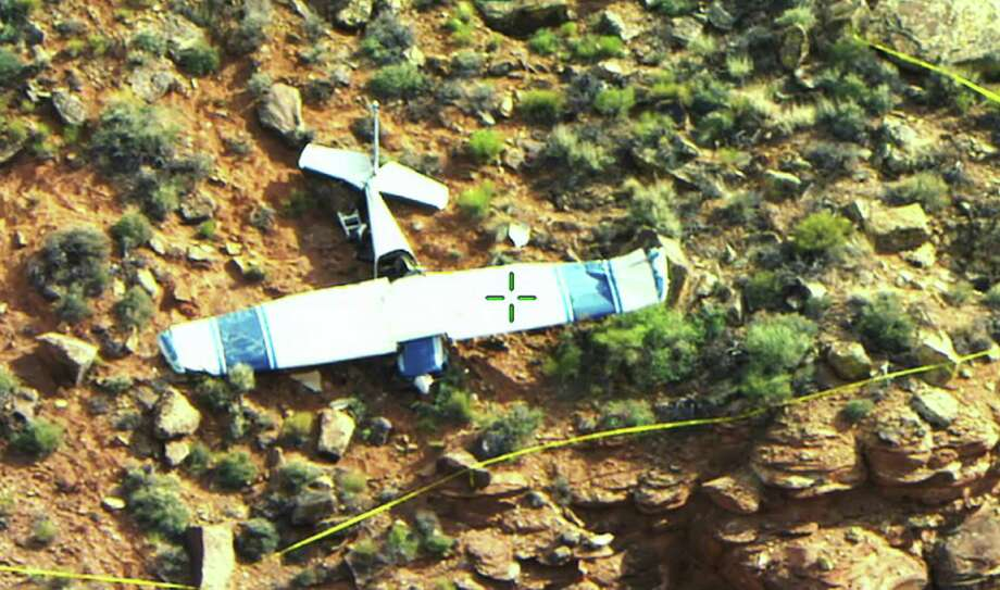 This Wednesday, May 7, 2014 photo provided by the Washington County sheriff shows the wreckage of a small plane that crashed, killing flight instructor Gary Hawes of St. George, Utah, and his student, Brad Brian, of Washington, Utah, near the town of Santa Clara, about 11 miles south of St. George. Police say they don't know what caused the crash or whether the pilot sent emergency signals. The cross-hairs on the plane were in the original photo provided by the source. Photo: Cory C. Pulsipher, AP  / Washington County Sheriff