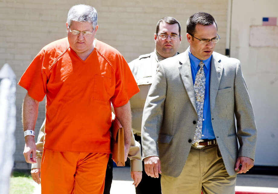 Bernie Tiede is escorted into the Panola County Courthouse, in Carthage, Texas, on Tuesday May 6, 2014. Tiede, a former mortician, whose killing of a rich widow shook an East Texas town and later inspired a movie was released on bond Tuesday after the district attorney who prosecuted him agreed to let him out of a life sentence. Photo: Michael Cavazos, AP  / AP2014