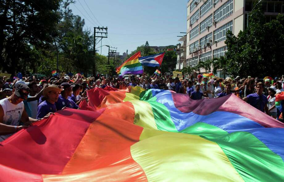 Marchers wave a giant pride banner at the start of a parade marking the upcoming International Day Against Homophobia, in Havana, Cuba, Saturday, May 10, 2014. International Day Against Homophobia is celebrated globally on May 17 commemorating the World Health Organization's declassification of homosexuality as a mental illness. Photo: Franklin Reyes, AP  / AP2014