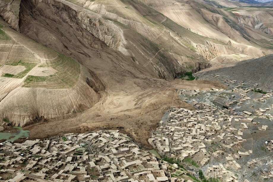 An aerial view shows the site of Friday's landslide that buried Abi Barik village in Badakhshan province, northeastern Afghanistan, Monday, May 5, 2014. Hundreds of people were killed in a horrific landslide and authorities are trying to help the 700 families displaced by the torrent of mud that swept through their village. The families left their homes due to the threat of more landslides, Minister for Rural Rehabilitation Wais Ahmad Barmak said. Photo: Rahmat Gul, AP  / THE ASSOCIATED PRESS2014