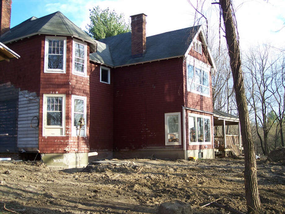 Before: The exterior of the home and the yard needed a lot of work. Read more about this project. Photo: Picasa, Joe Keegan