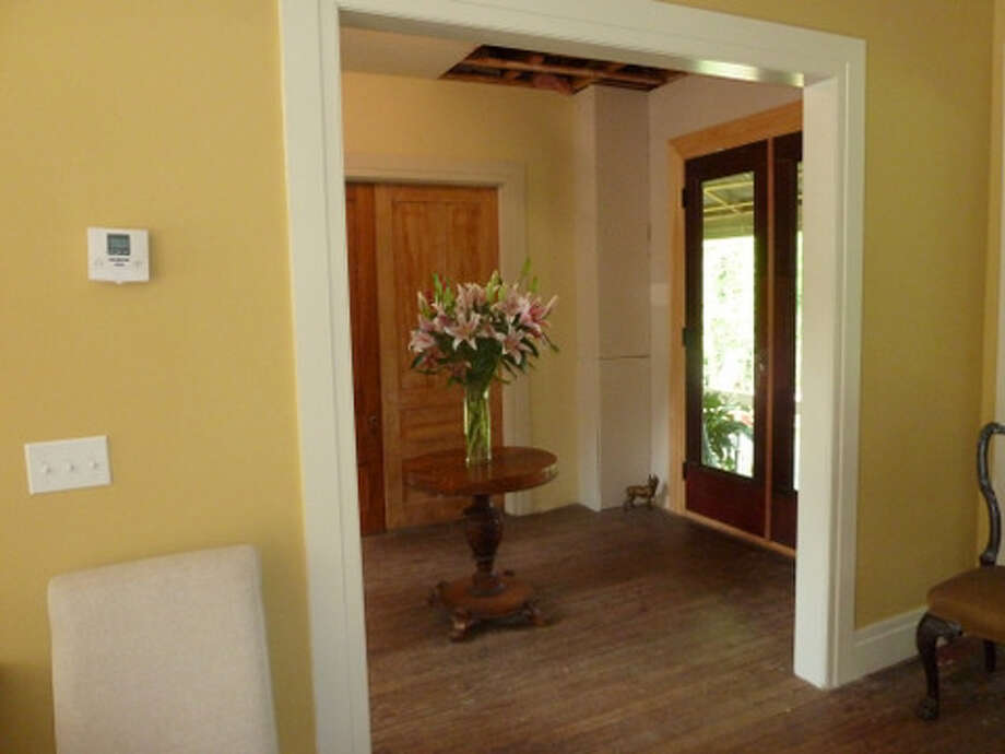 After: The same view from the dining room into the other parlor.Read more about this project. Photo: Picasa, Joe Keegan