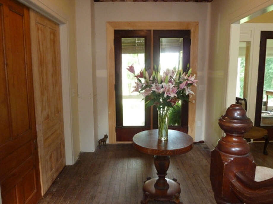 After: Doors have been restored as well as the original parlor opening. Read more about this project. Photo: Picasa, Joe Keegan