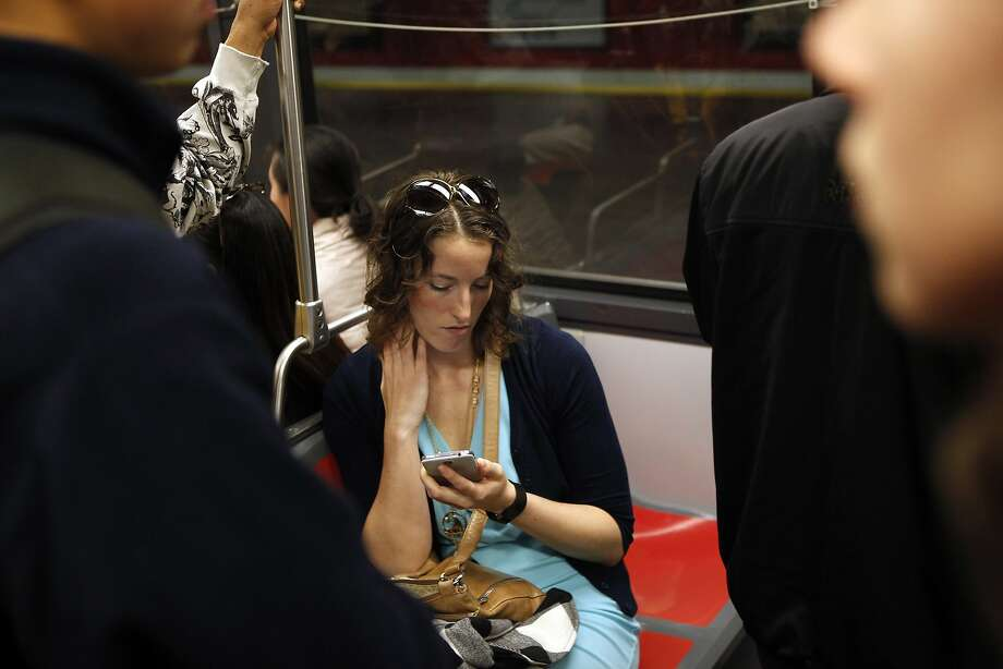 Rachel Davidson plays a game on her smartphone on an inbound N-Judah train. Theft of phones is a leading crime on Muni. Photo: Michael Short, The Chronicle