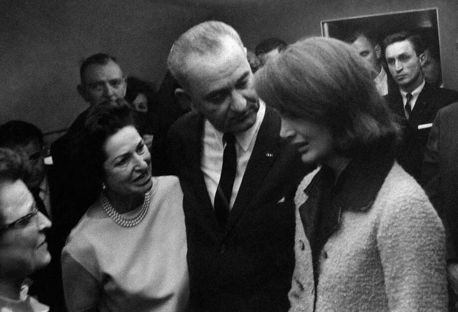 Lem Johns (background right), behind Jacqueline Kennedy and new President Lyndon Johnson and his wife, Lady Bird, after John F. Kennedy's assassination on Nov. 22, 1963. Photo: Cecil Stoughton, Associated Press
