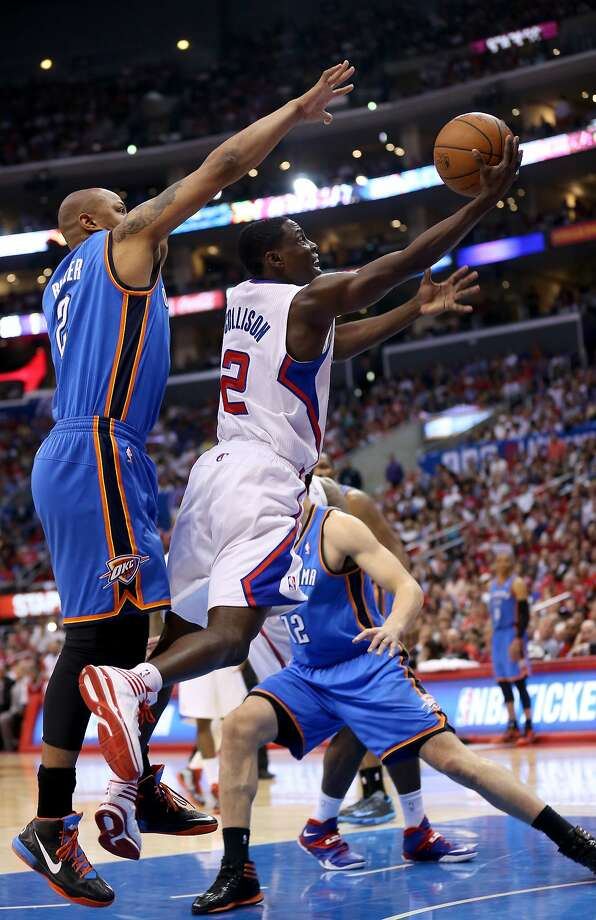 Darren Collison weaves his way through traffic in coming up big for the Clippers against the Thunder. Photo: Stephen Dunn, Getty Images
