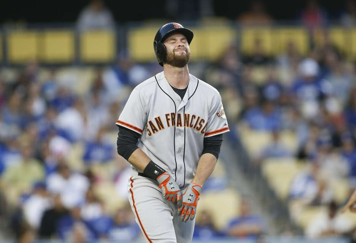 San Francisco Giants' Brandon Belt reacts after being hit by a pitch on his left hand and breaking his thumb against the Los Angeles Dodgers during the second inning of a baseball game, Friday, May 9, 2014, in Los Angeles. (AP Photo/Danny Moloshok)