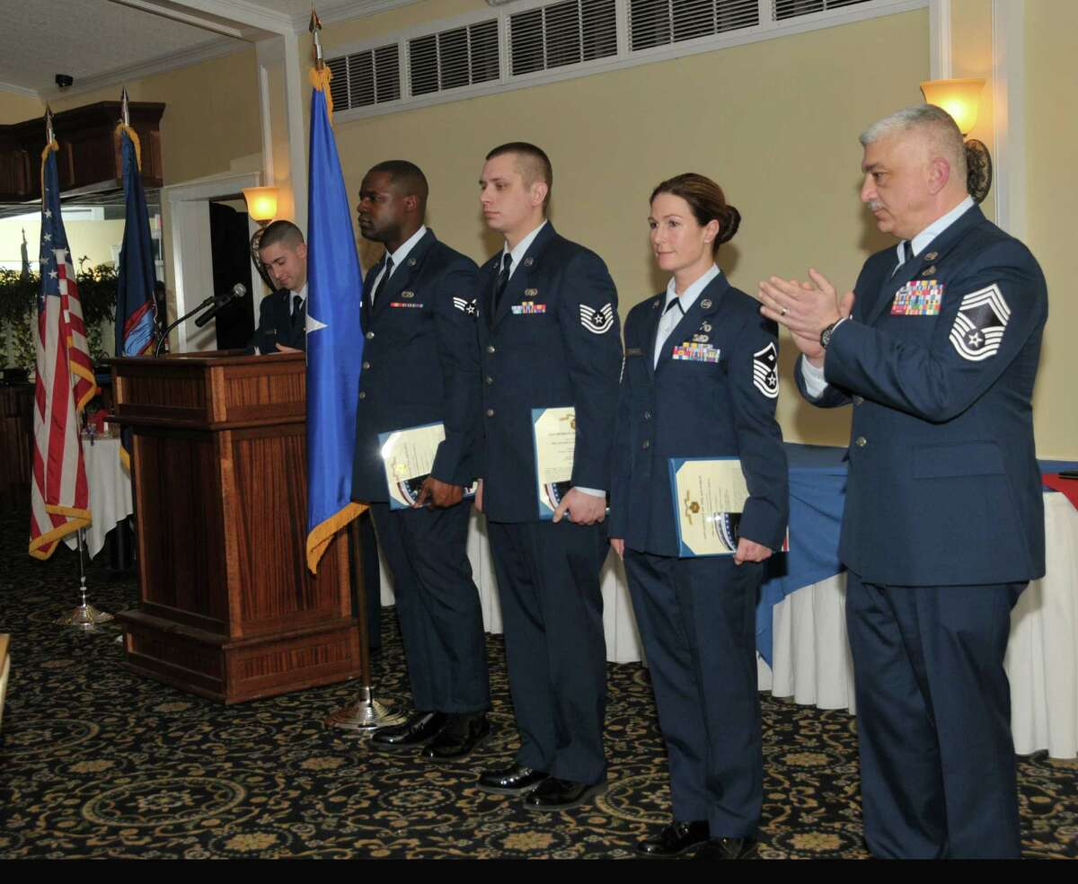 Senior Airman Kylief Tucker, Airman of the Year, Tech. Sgt. Robert Harrington, NCO of the Year, and Master Sgt. Amanda Blodgett, First Sergeant of the Year, were all honored during the 109th Airlift Wing's annual Airmen of the Year Dinner on April 4. Chief Master Sgt. Mark Mann (right) accepted the award for Senior Master Sgt. Patrick FitzGerald (not pictured), Senior NCO of the Year. Tucker is assigned to the 109th Maintenance Squadron, Harrington is assigned to the 109th Communications Flight, Blodgett is assigned to the 109th Logistics Readiness Squadron, and FitzGerald is assigned to the 109th Small Air Terminal. (Air National Guard photo by Master Sgt. William Gizara)