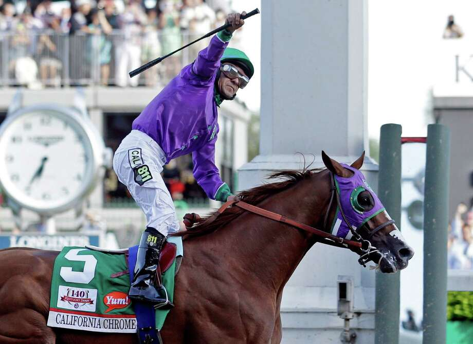 FILE - In this May 3, 2014, file photo, jockey Victor Espinoza celebrates aboard California Chrome after winning the 140th running of the Kentucky Derby horse race at Churchill Downs in Louisville, Ky. The California colt will be running in the Preakness with a bulls-eye on his back as perhaps racing's next superstar. He figures to face eight or nine rivals in the middle leg of the Triple Crown series, and one of them might be a filly.  (AP Photo/Morry Gash, File) ORG XMIT: DBY163 Photo: Morry Gash / AP