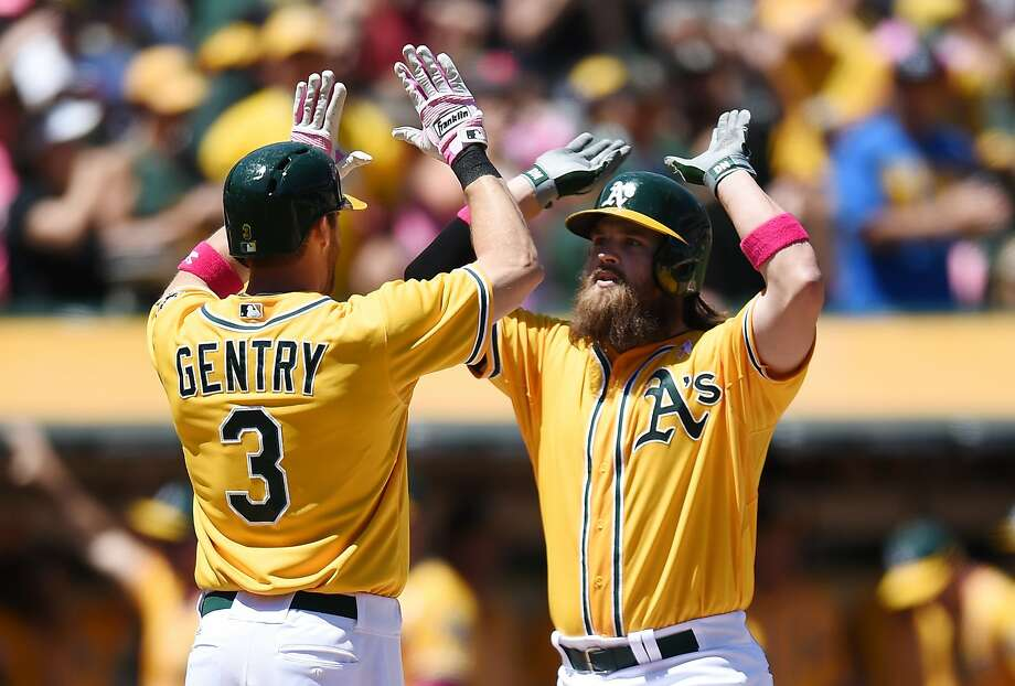 Derek Norris and Craig Gentry gear up for a high 10 after the second of Norris' three-run homers put the A's ahead 7-0. Photo: Thearon W. Henderson, Getty Images