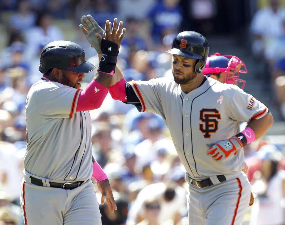 San Francisco Giants' Pablo Sandoval, left, congratulates Brandon Hicks for hitting a two-run home run in the seventh inning of a baseball game against the Los Angeles Dodgers on Sunday, May 11, 2014, in Los Angeles. (AP Photo/Alex Gallardo) Photo: Alex Gallardo, Associated Press