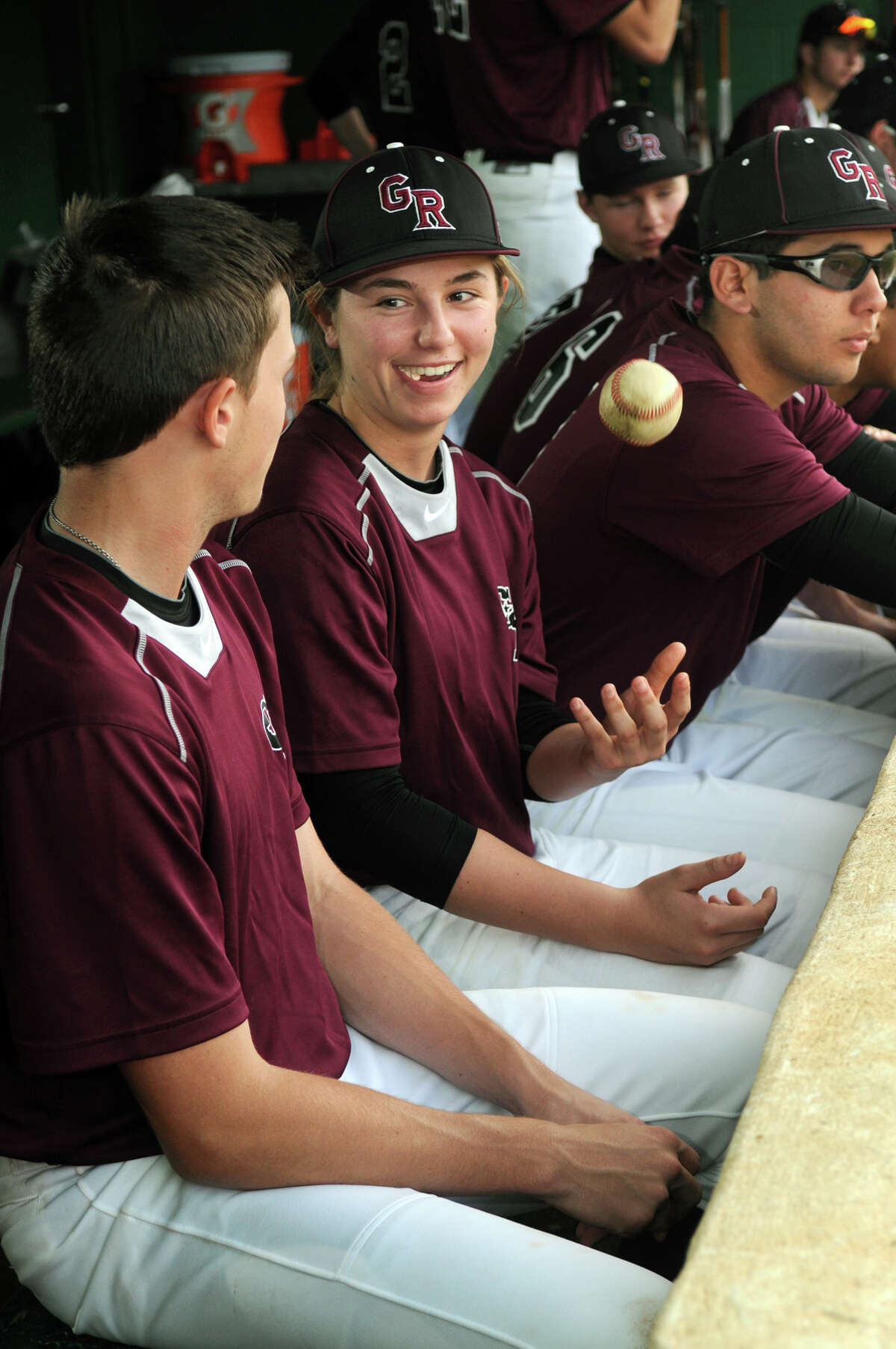 Sarah Hudek, center, a junior at George Ranch High School and a pitcher with the Longhorns, stays loose with teammates Kevin Kupps, left, a junior pitcher, and Gabe Rodriguez, right, a junior pitcher/outfielder, during a recent game.
