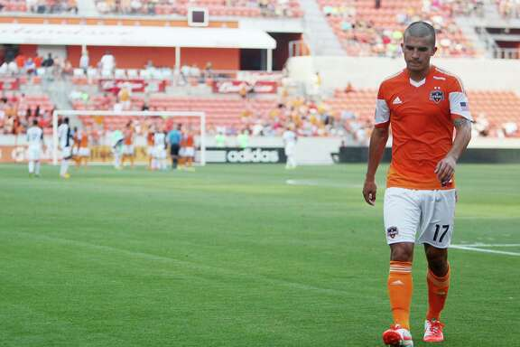 Houston Dynamo (#17) Servando Carrasco is ejected in the first half during the soccer game the Real Salt Lake at BBVA Compass Stadium on May 11, 2014, in Houston Tx.
