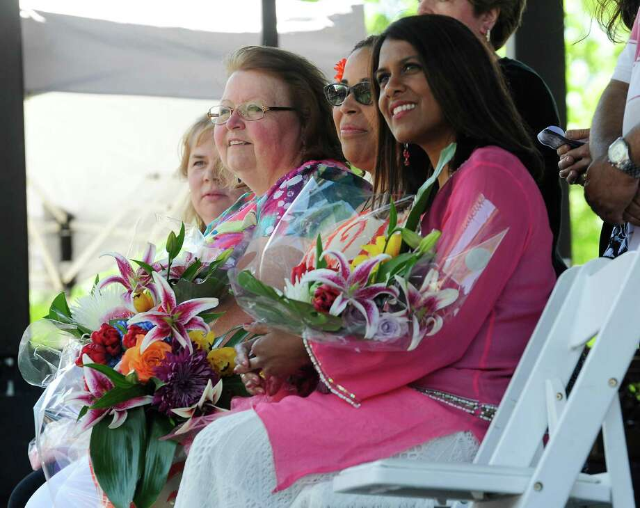 Mother of the Year nominees, from left to right, Marcia Andersen, Patricia Dowse, Laurel McAdoo and Fazana Saleem-Ismail, wait to hear which one of them has won during the 16th annual Mother of the Year Contest at the Albany Tulip Festival on Sunday, May 11, 2014, in Albany, N.Y.   Marcia Andersen , a mother to three biological children and hundreds of foster children, won this year's Mother of the Year.   (Paul Buckowski / Times Union) Photo: Paul Buckowski / 00026758A